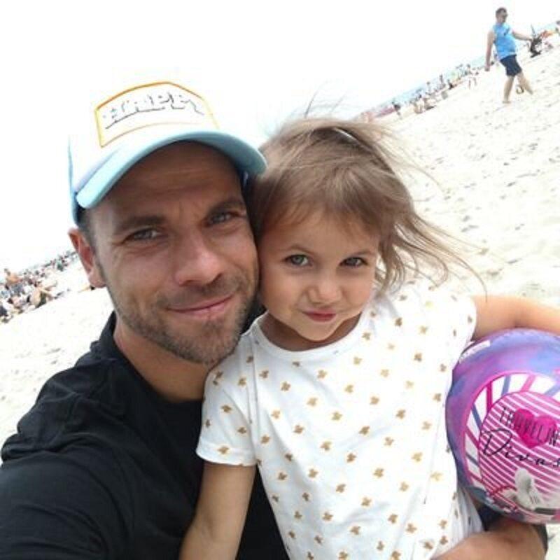 Filip Burkhardt z córką