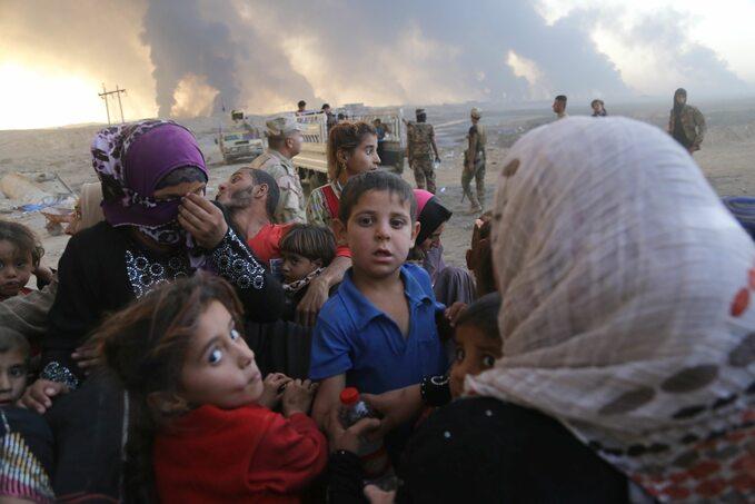 Irakijczycy uciekający zMosulu zajętego przez ISIS
