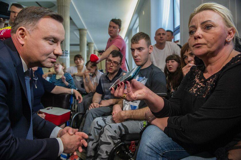 Prezydent Andrzej Duda na spotkaniu z niepełnosprawnymi i ich rodzinami w Sejmie